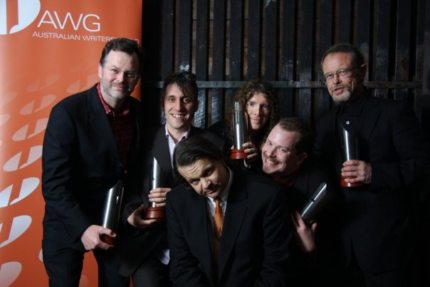 GNW writers pose awkwardly with AWGIE Awards