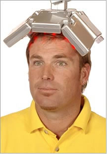 Shane Warne and a metal head-warmer